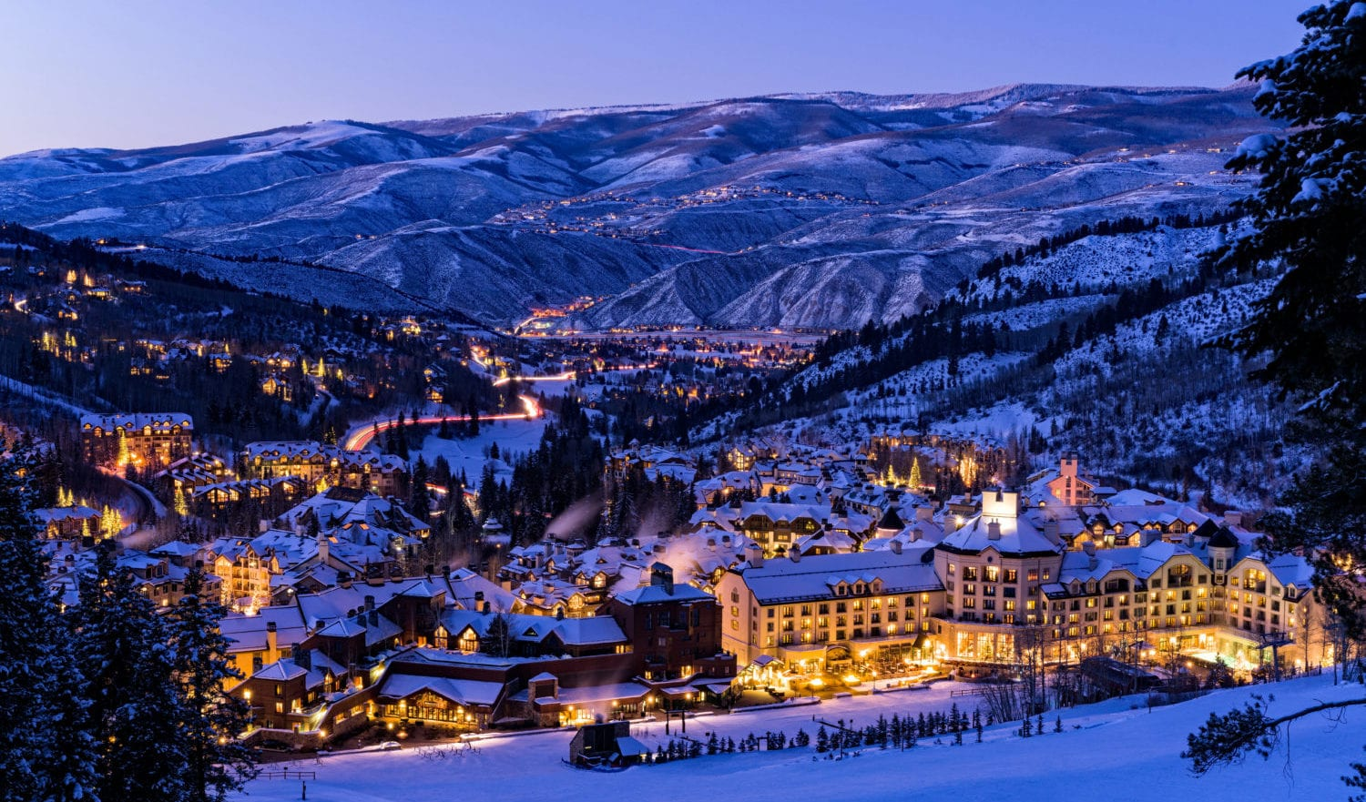 Beaver Creek Resort Winter Skiing at Dusk - Scenic view of village illuminated at night with ski runs.
