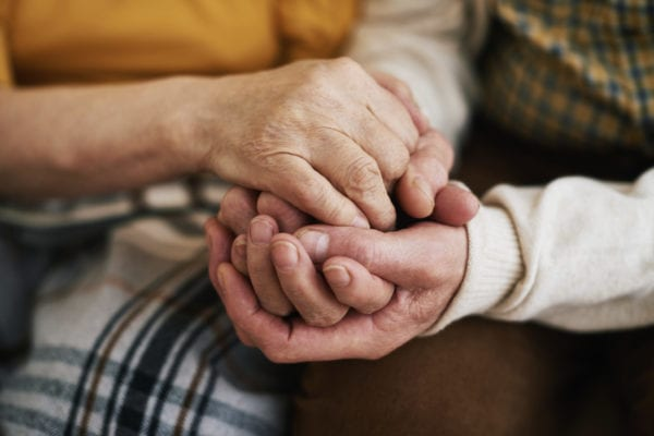 Close-up of holding seniors hands